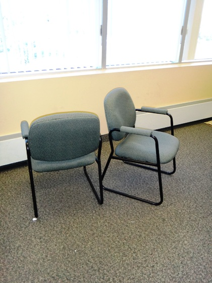 Arm side chairs with sled base.