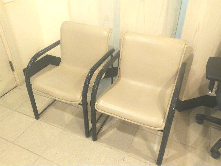 Leather arm side chairs in cream colour